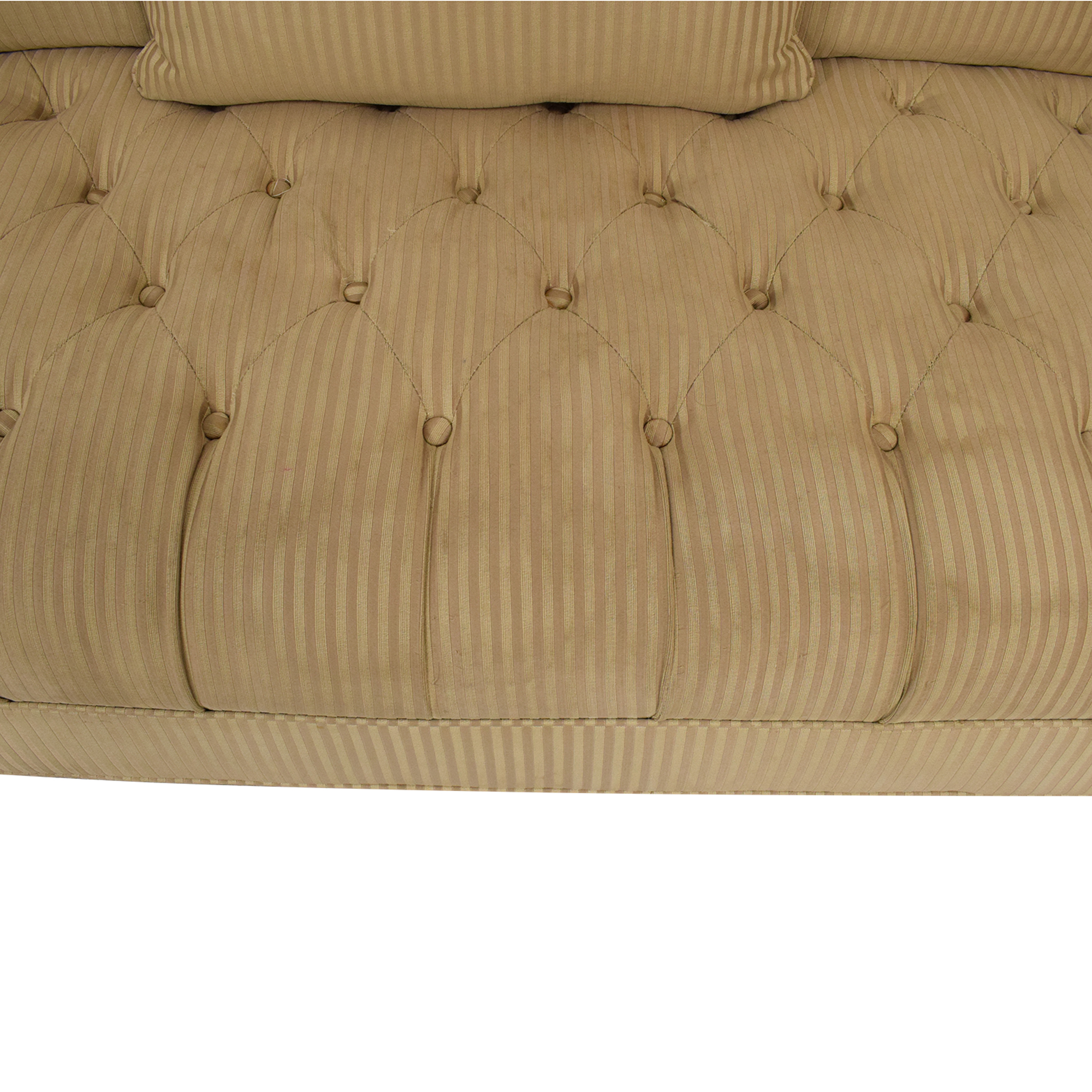 Rooms To Go Rooms To Go Tufted Roll Arm Chesterfield Sofa tan
