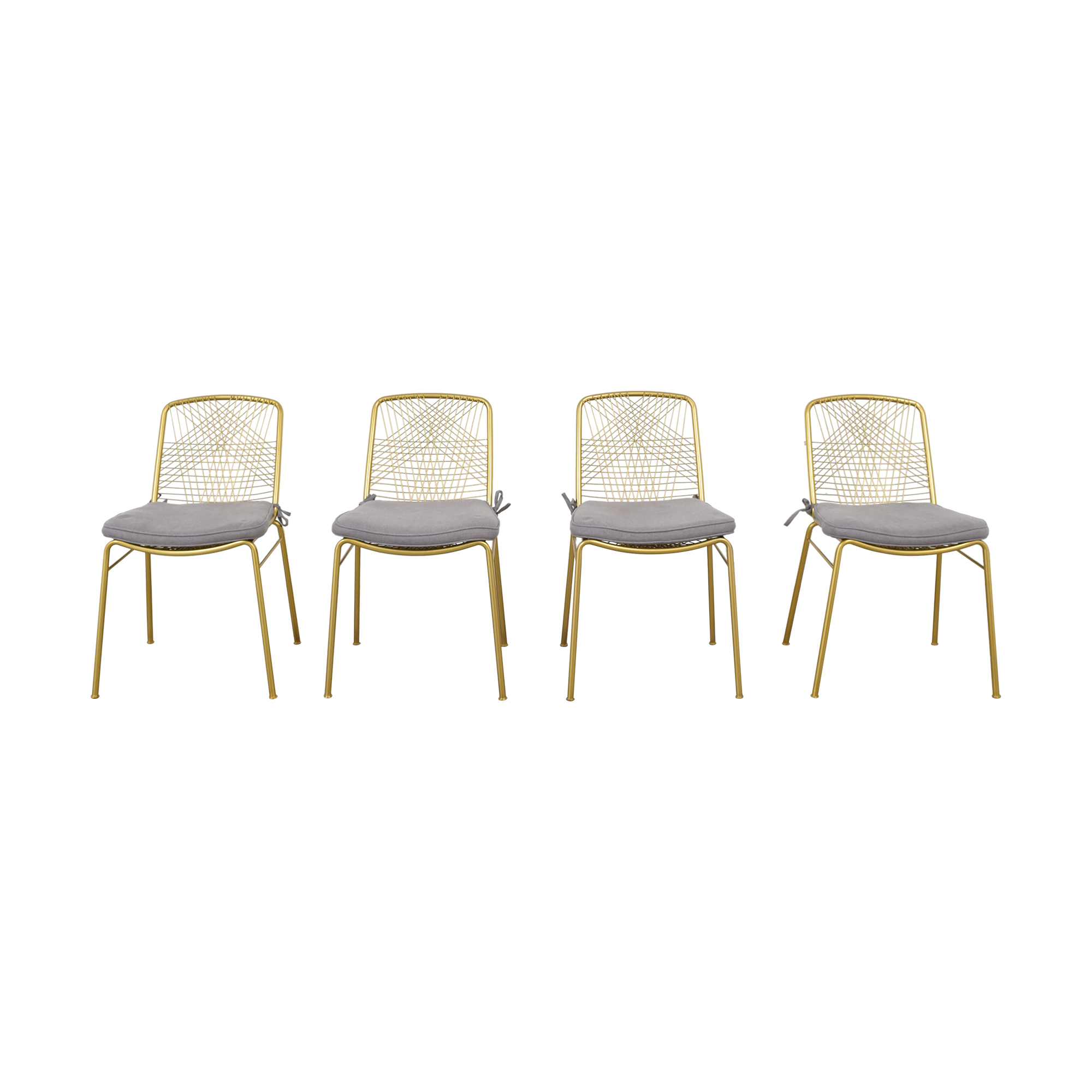 CB2 CB2 Alpha Brass Dining Chairs with Pier 1 Cushions nyc