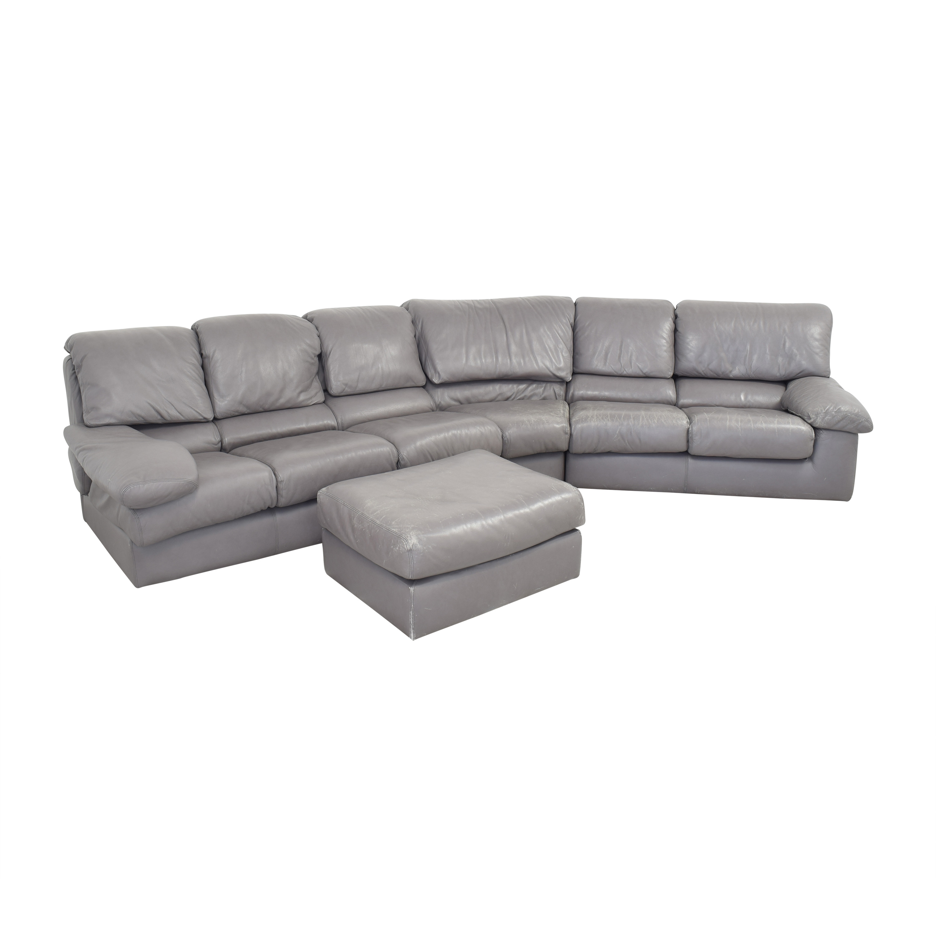 Leather Center Leather Center Curved Sectional Sofa with Ottoman used