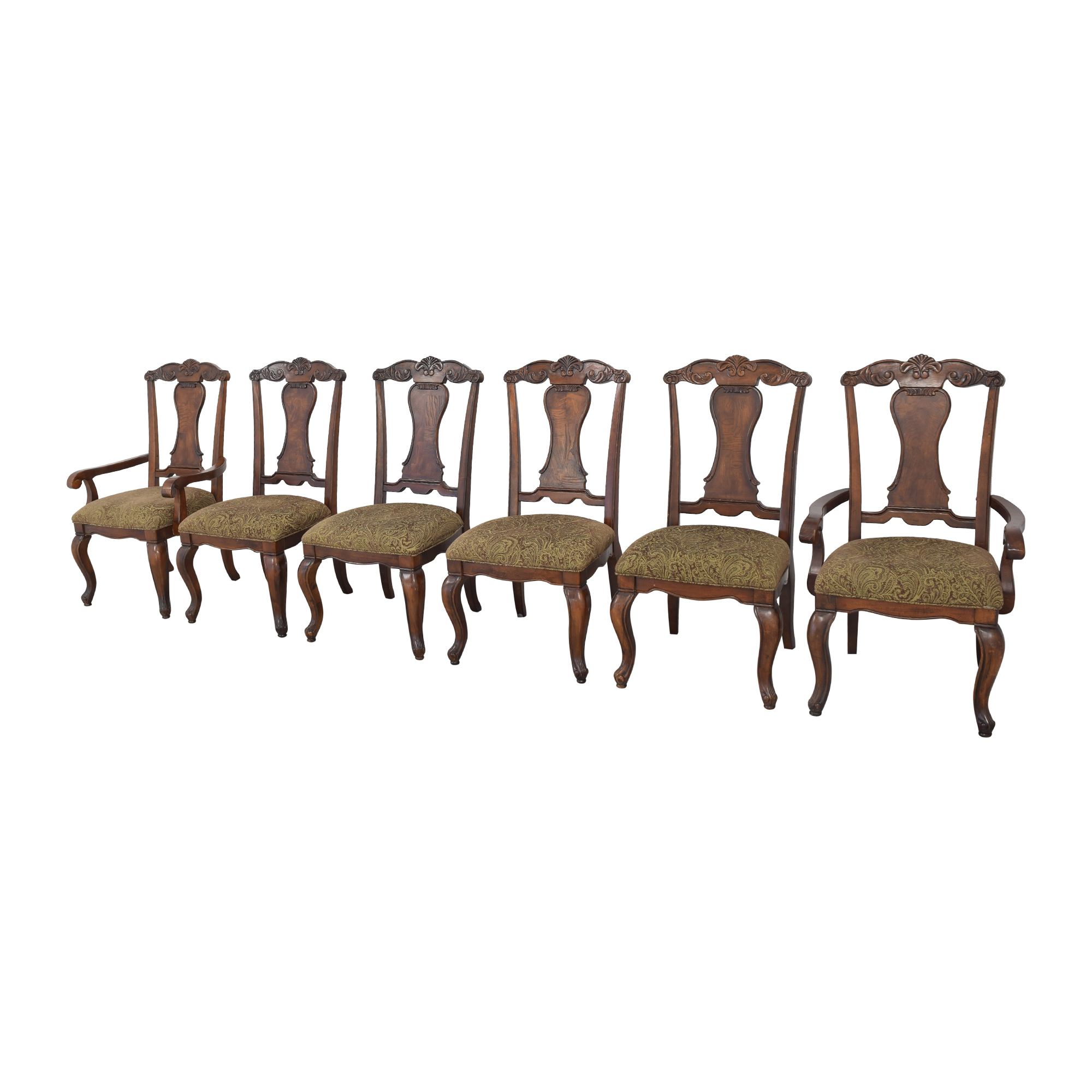 Raymour & Flanigan Carved Dining Chairs sale