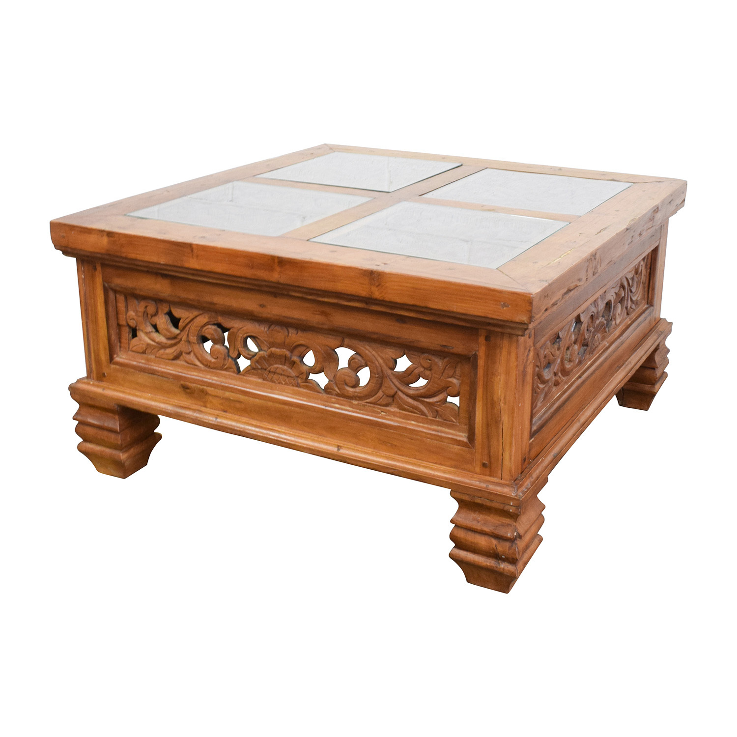 Off teak carved coffee table with glass top tables