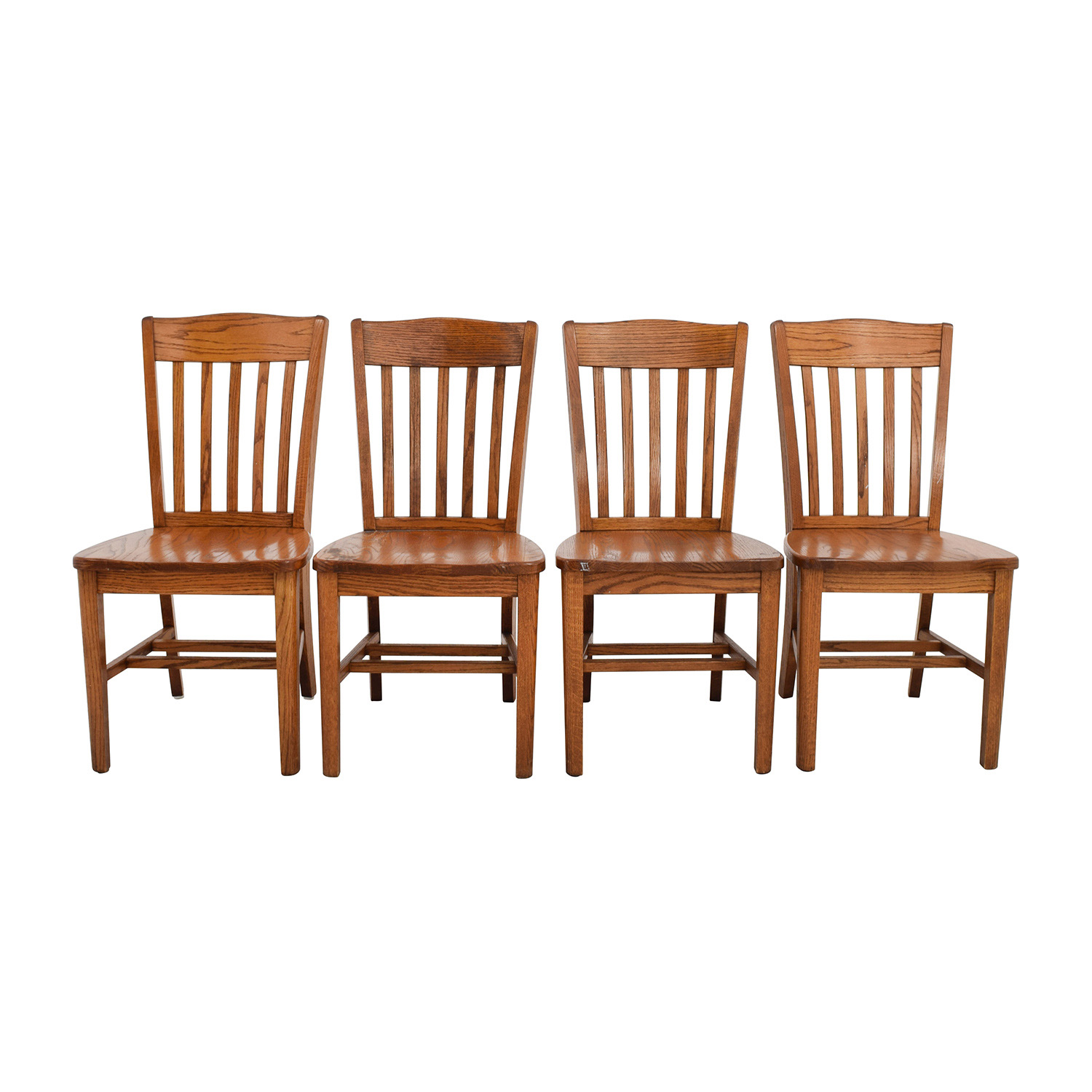 Four Brown Slat Back Wood Chairs used