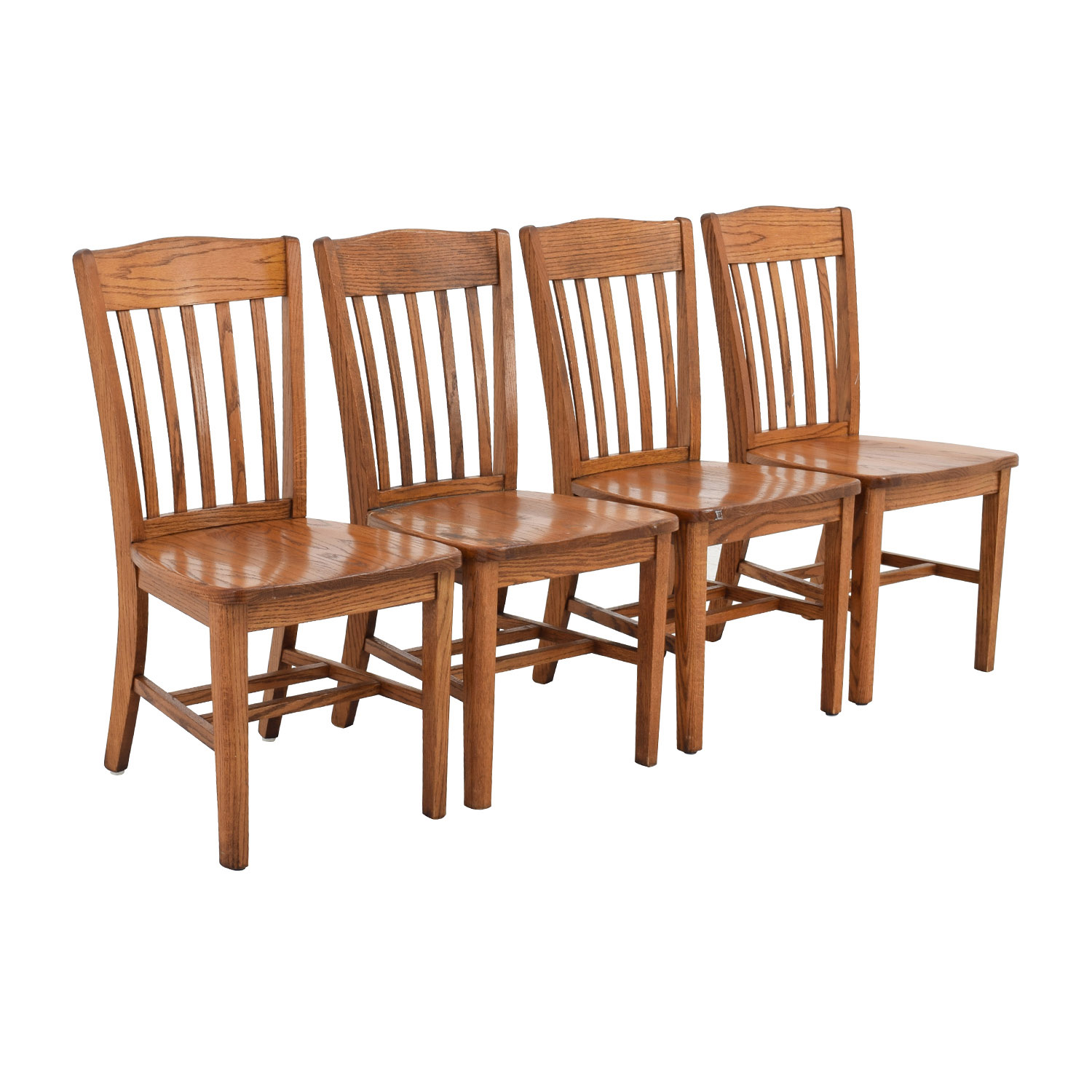 Slatted Back Chairs ~ Off four brown slat back wood chairs