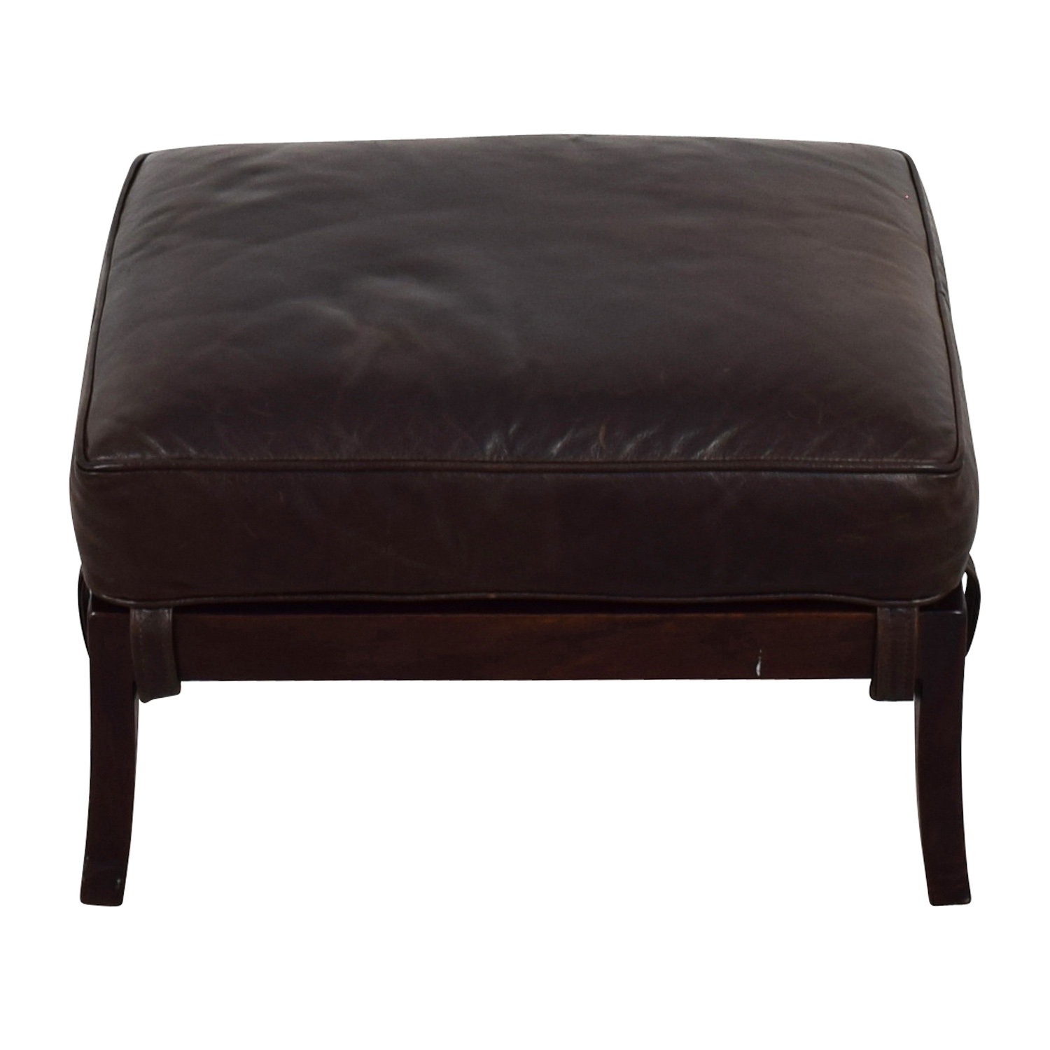 shop Crate & Barrel Blake Carbon Grey Ottoman with Leather Cushion Crate and Barrel Ottomans