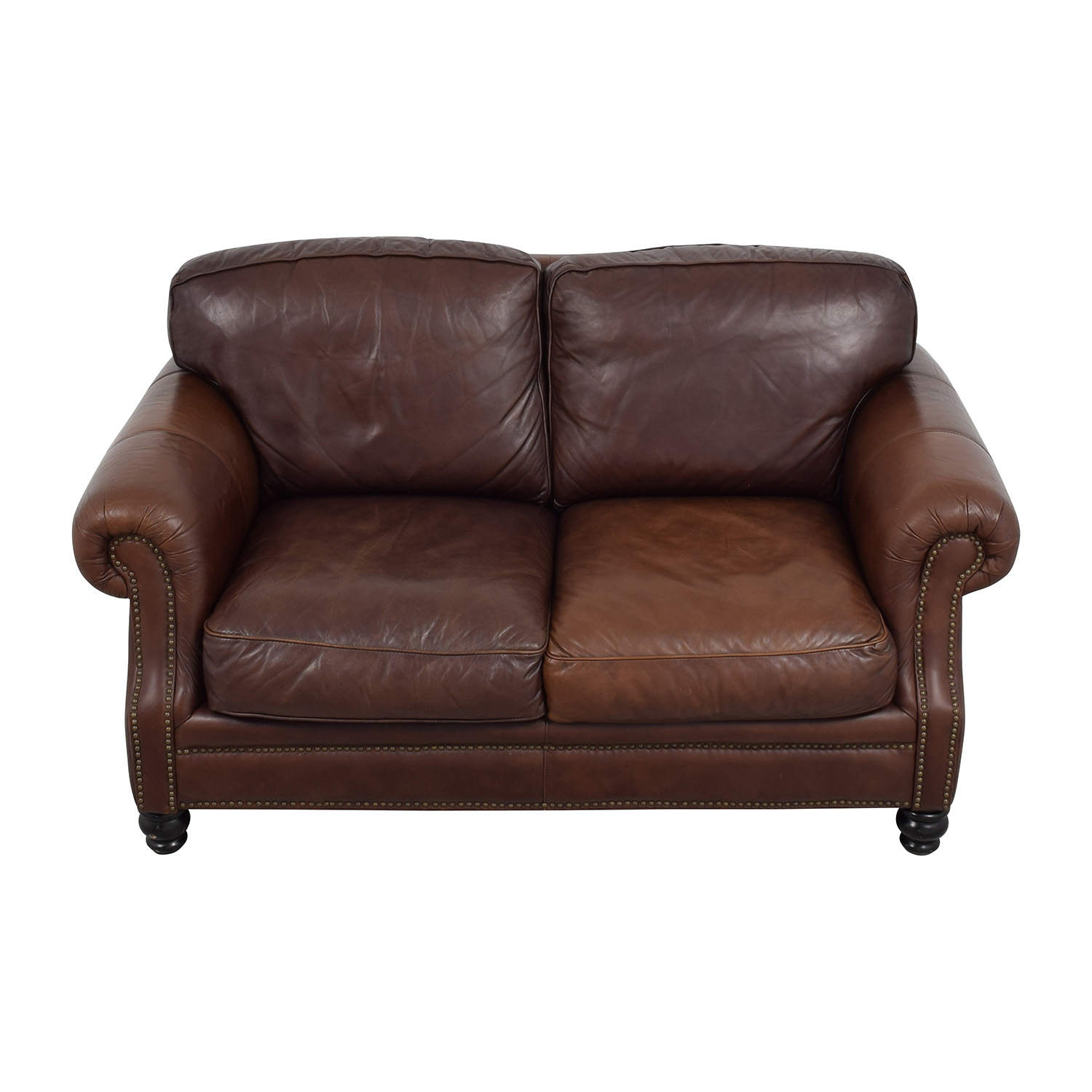 Brown Leather Studded Loveseat on sale