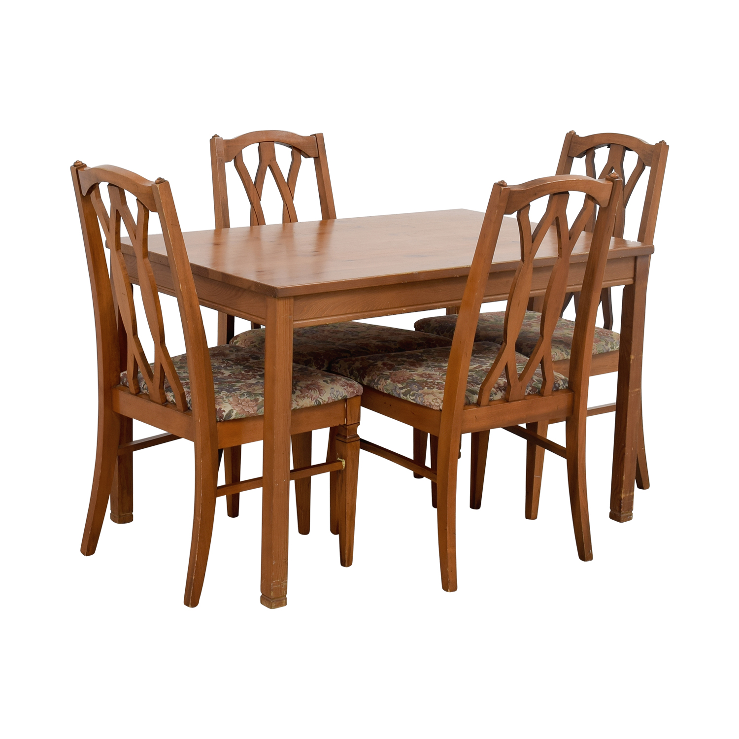Off wood kitchen table and floral upholstered chairs
