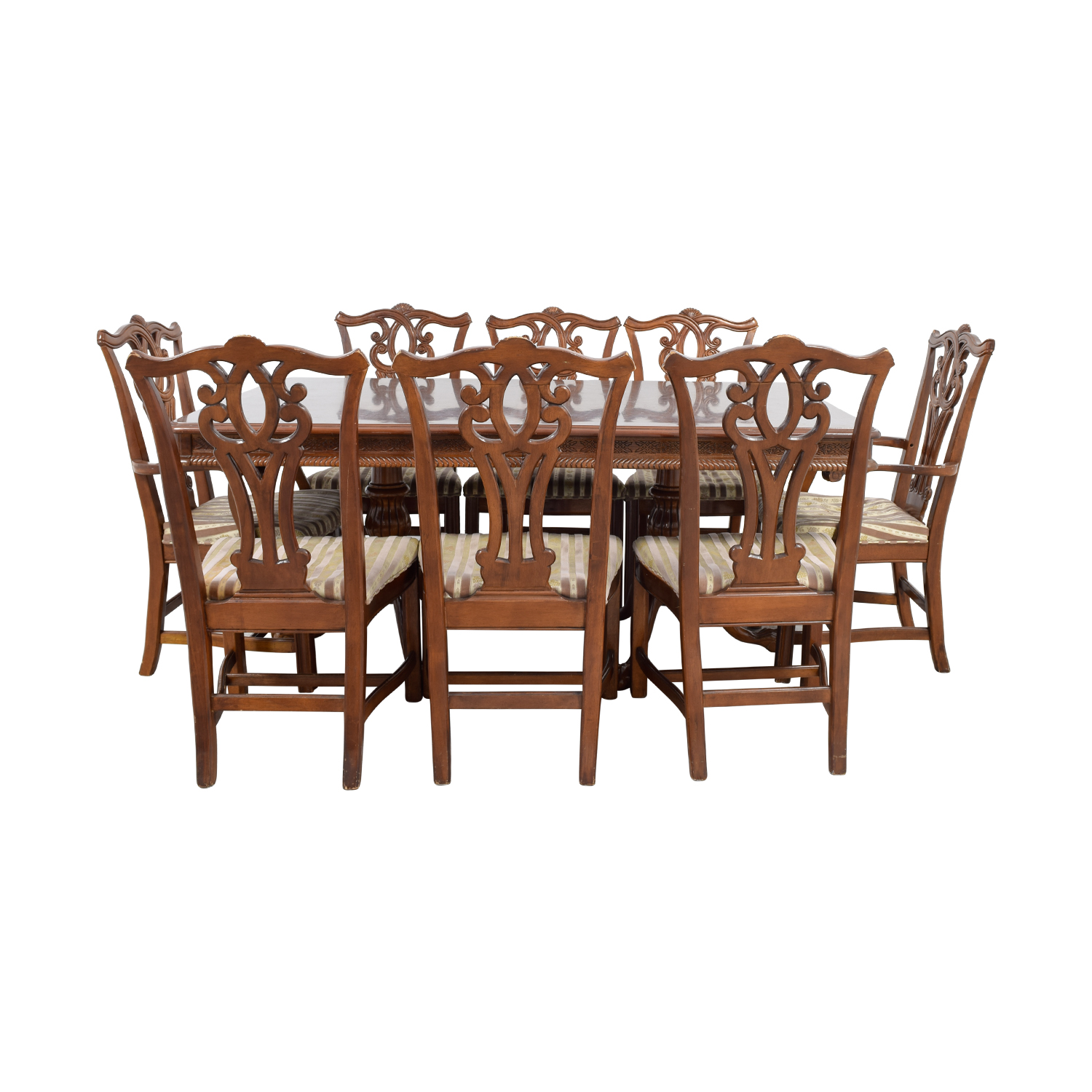 shop Carved Wood Dining Set with Two Extensions and Eight Chairs Dining Sets