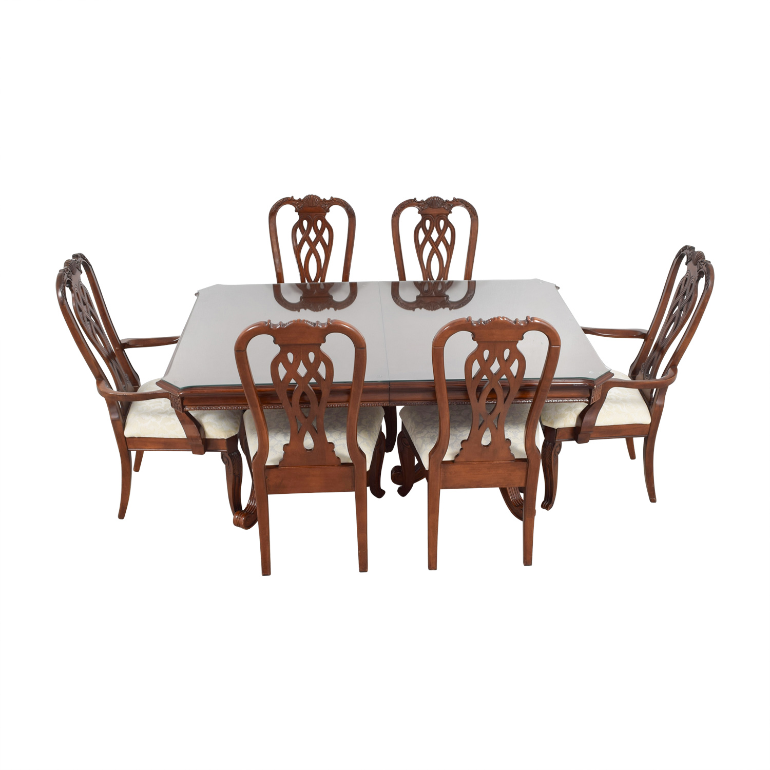 Carved Wood Dining Set with Creme Upholstery and Glass Surface Protector on sale