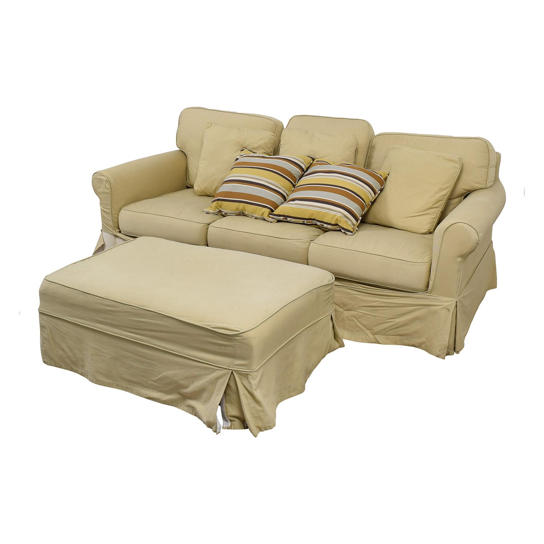 Ballard Design Beige Three-Cushion Couch and Ottoman / Sofas