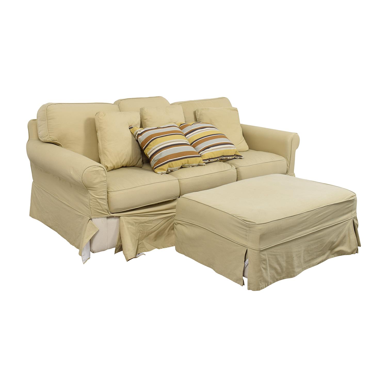 Ballard Design Ballard Design Beige Three-Cushion Couch and Ottoman nyc