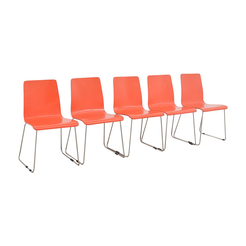 shop CB2 Echo Orange Dining Chairs CB2