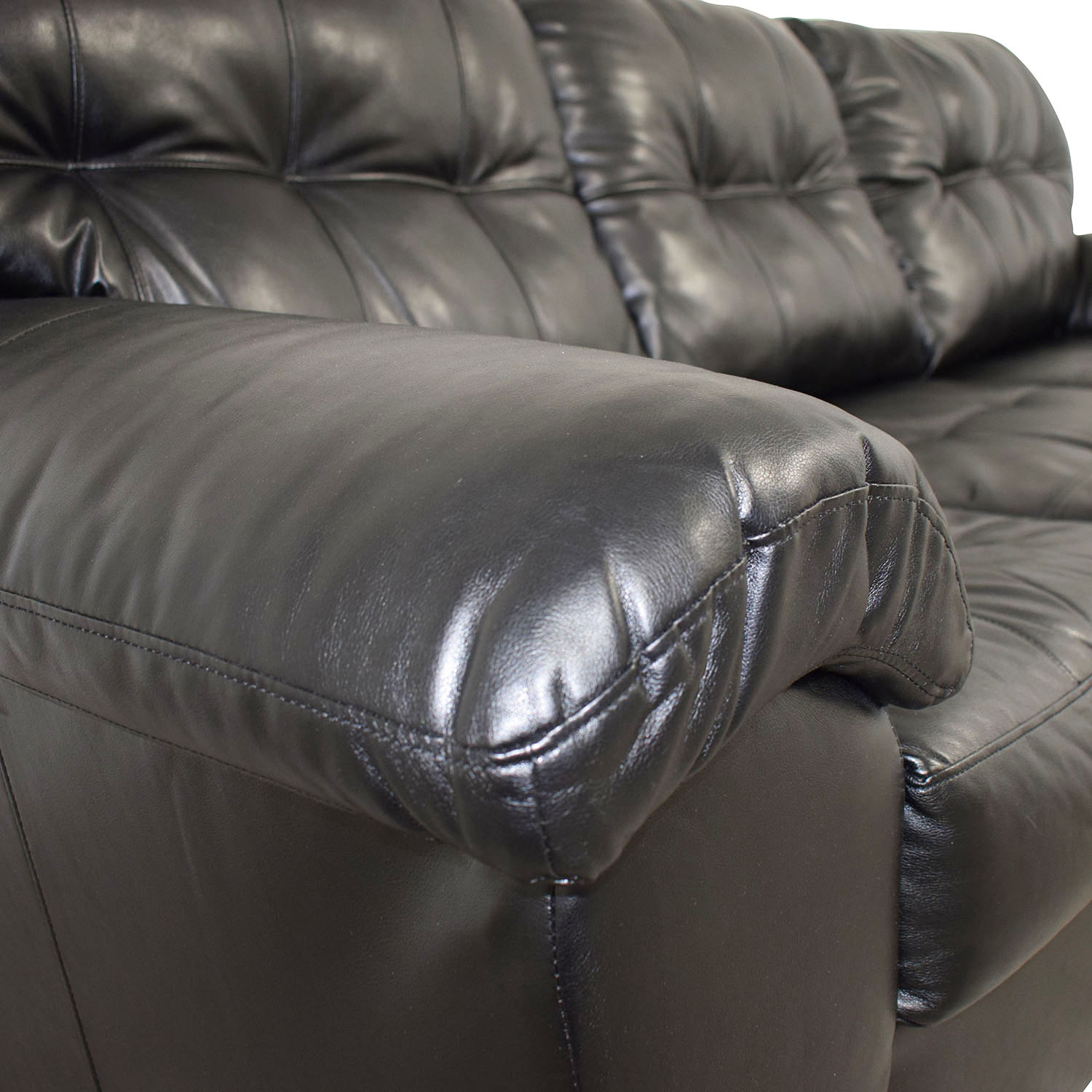Black Tufted Leather Three-Cushion Couch