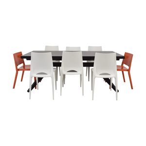Design Within Reach Wood Extendable Table with White and Orange Chairs nyc