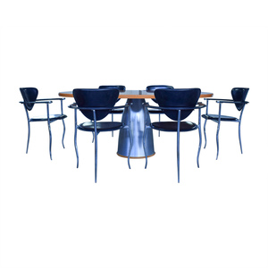 Cattelan Italia Cattelan Wood and Steel Table with Black Chairs Dining Set used