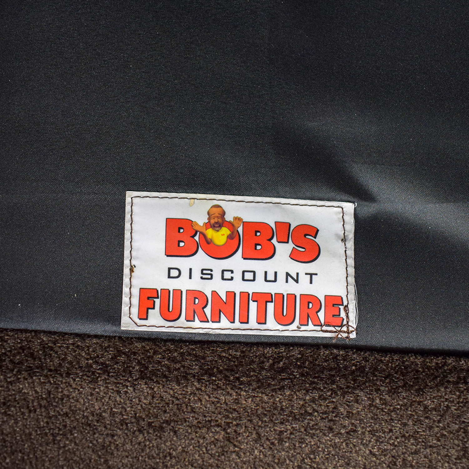 shop Bob's Furniture Brown Two-Cushion Love Seat Bob's Furniture Loveseats