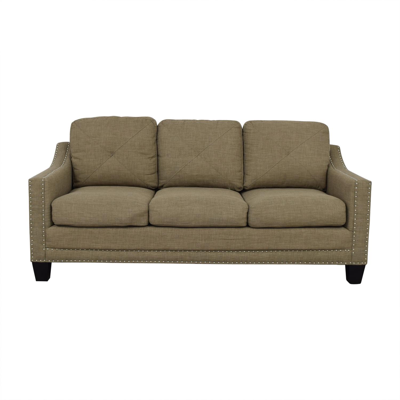 shop Bob's Furniture Tan Three-Cushion Couch Bob's Furniture Classic Sofas