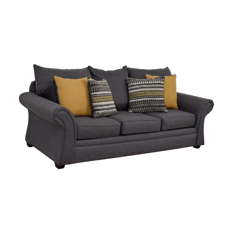 Grey Sofa with Gold Throw Pillows