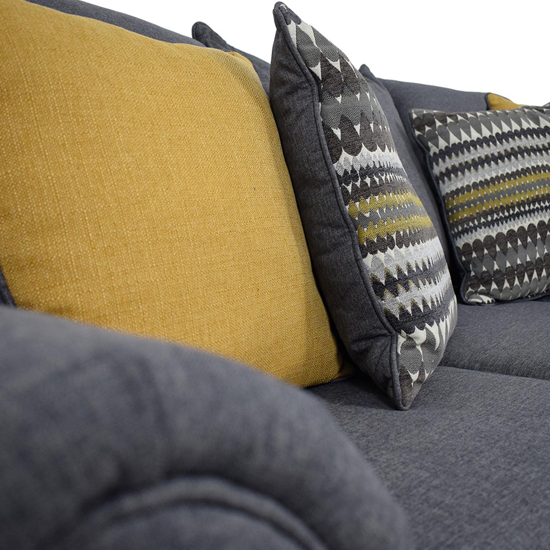 Grey Sofa with Gold Throw Pillows nyc