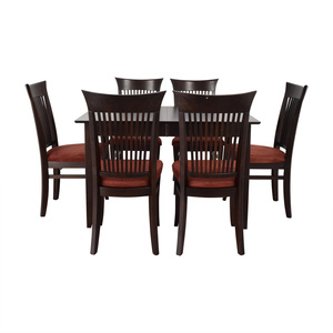 shop Fortunoff Dining Table with Burgundy Upholstered Chairs Fortunoff