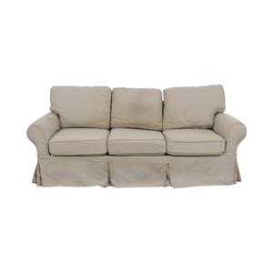Pottery Barn Pottery Barn Beige Three-Cushion Skirted Sofa for sale