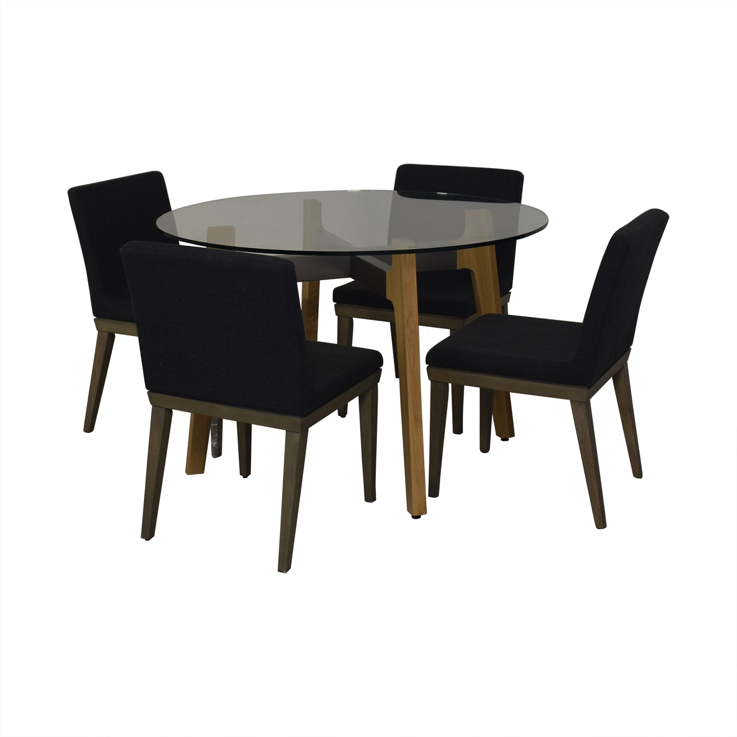 shop CB2 Glass Dining Room Table with Four Chairs CB2