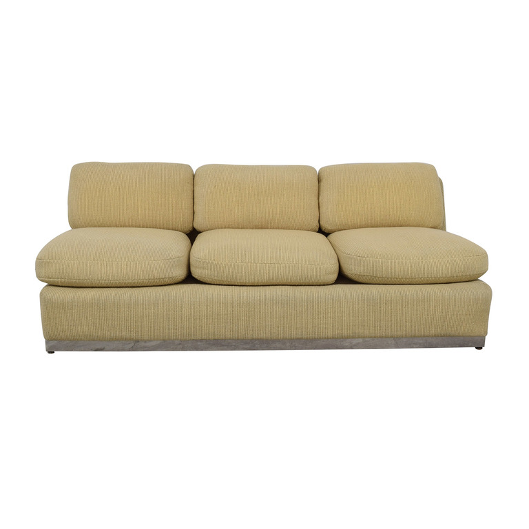 Off White Armless Three Cushion Couch
